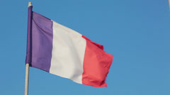 France national flag waving on flagpole on blue sky background Stock Footage