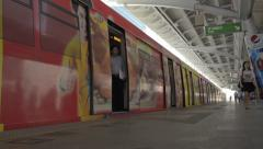 Doors Closing as Train Departs from Skytrain Station in Bangkok Stock Footage