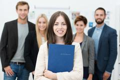 Businesswoman holding her curriculum vitae Stock Photos