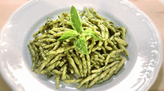 Pasta with pesto Stock Footage