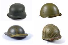 Fours military helmets Stock Photos