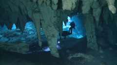 Underwater cave - scuba diver silhouette Stock Footage