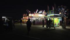 Stock Video Footage of carnival fair fairground night people lifestyle summer fun family entertaining
