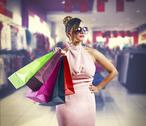 Stock Photo of beautiful young woman holding shopping bags