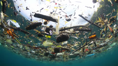 underwater garbage - trash floating at sea, two footage - stock footage