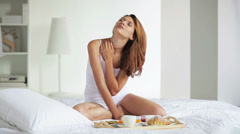 Young women waking up stretching in the morning on bed - stock footage