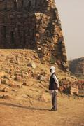 Stock Photo of local guard walking around tughlaqabad fort, new delhi