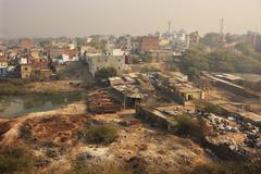 slums of new delhi seen from tughlaqabad fort - stock photo