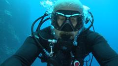 Scuba diver swimming, self image Stock Footage