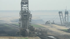 Digging for brown coal in an opencast mining in Germany - stock footage