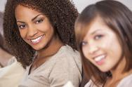 Stock Photo of beautiful mixed race african american girl & chinese asian friend