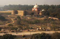 mausoleum of ghiyath al-din tughluq seen from tughlaqabad fort, new delhi - stock photo