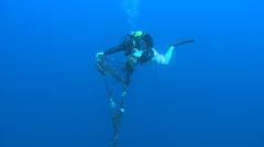 Scuba diver drop down a fishing net to deep. Stock Footage