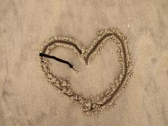 Broken heart on the beach Stock Photos