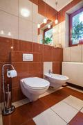 Toilet interior Stock Photos
