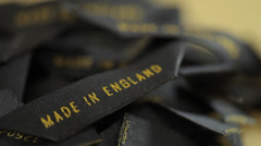 Close up of clothing labels made in england Stock Footage
