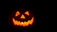 Pumpkin with burning candle Stock Footage