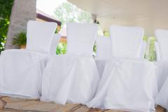 White chairs in banquet hall Stock Photos