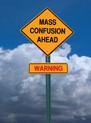 Mass confusion ahead sign Stock Photos