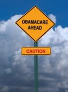 Obamacare ahead caution conceptual post Stock Photos