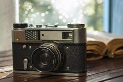 vintage camera and old book on table - stock photo