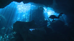 Underwater cave with swimming scuba diver silhouette Stock Footage