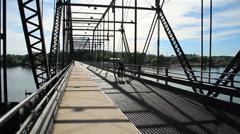Pedestrian bridge over river Stock Footage