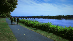 People Walking along river Stock Footage