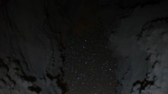 Stock Video Footage of Astrophotography Time Lapse -Universe seen thru Cave- Vertical Pan