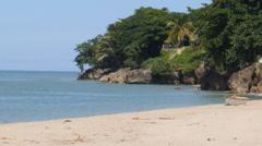 Tropical sandy beach with rock shore-Crash Boat Beach-Aguadilla-Puerto Rico Stock Footage