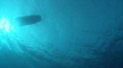 small boat from underwater at sunlight Stock Footage