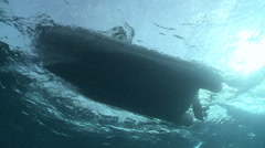 Diving boat at sunlight - underwater view Stock Footage