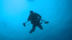 Scuba diver photographer silhouette - sink Stock Footage