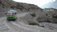 Stactic shot of bus on extreme roads of Nepal. - stock footage