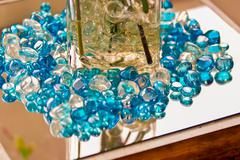 Blue marbles on a reflective surface Stock Photos