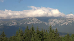 Big fluffy clouds in the Carpathian Mountains, skyline Stock Footage