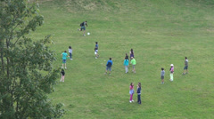 Happy children playing football game on a playground, summer camp Stock Footage