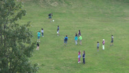 Stock Video Footage of Happy children playing football game on a playground, summer camp
