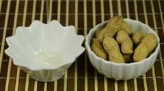 Peanut oil and peanuts Stock Footage
