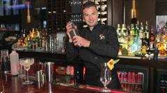 Handsome bartender making cocktail Stock Footage
