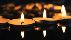 Candles burning in the dark - stock footage