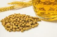 Stock Photo of hops pellets with beer glass