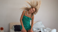 Attractive blonde shaking her hair - stock footage