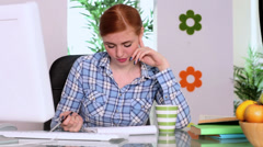 Beautiful focused brunette working on desk Stock Footage