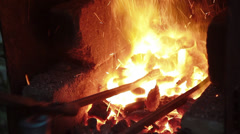 Metal bars in a forge furnace Stock Footage