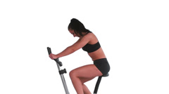 Tone brunette spinning on exercise bike Stock Footage