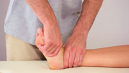 Stock Video Footage of Physiotherapist working on a patients foot