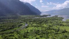Stock Video Footage Flying over Lake Teletskoye in the mountains Stock Footage