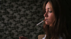 Attractive brunette smoking cigarette Stock Footage