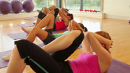Stock Video Footage of Fitness class and instructor doing abdominal crunches